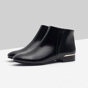 Zara black booties with gold heels